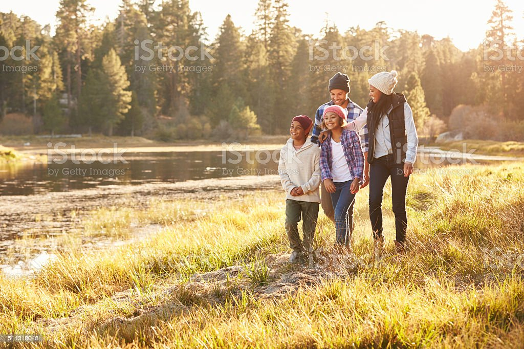 African American Family Walking By Lake stock photo