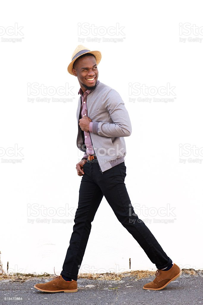 African american fashion model walking outdoors stock photo