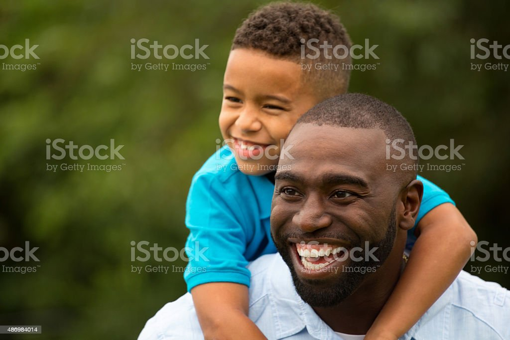 African American father and bi racial son stock photo