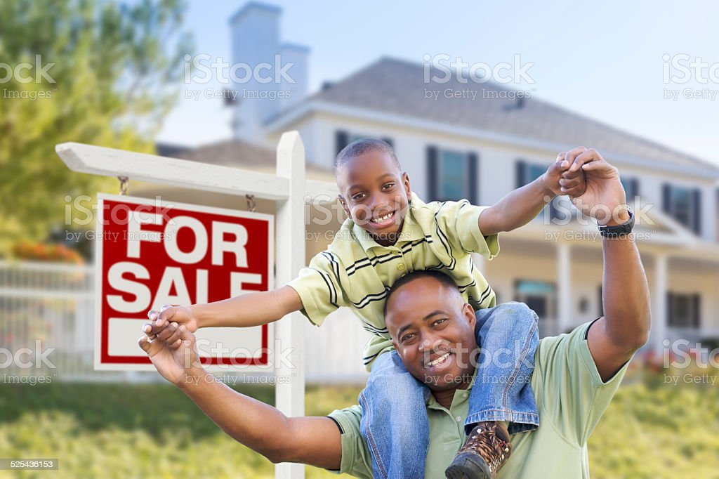 African American Father and Son, Sale Sign and Home stock photo