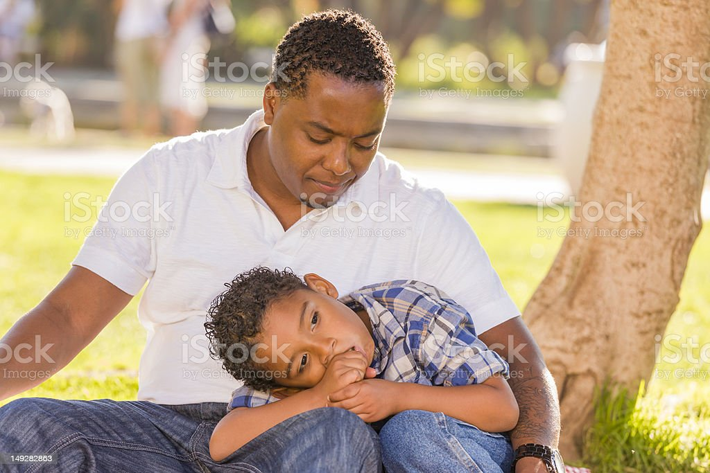 African American Father Worried About His Mixed Race Son stock photo