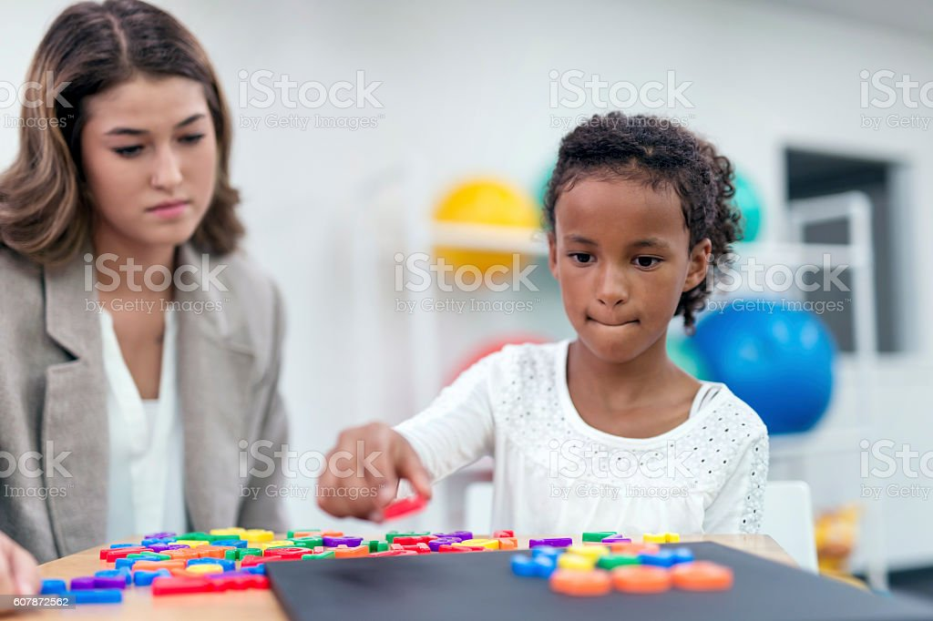 African american female child doing a puzzle exercise stock photo