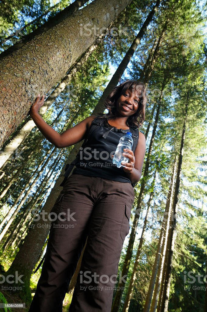 African American Female Hiker Holding Bottle Of Mineral Water royalty-free stock photo