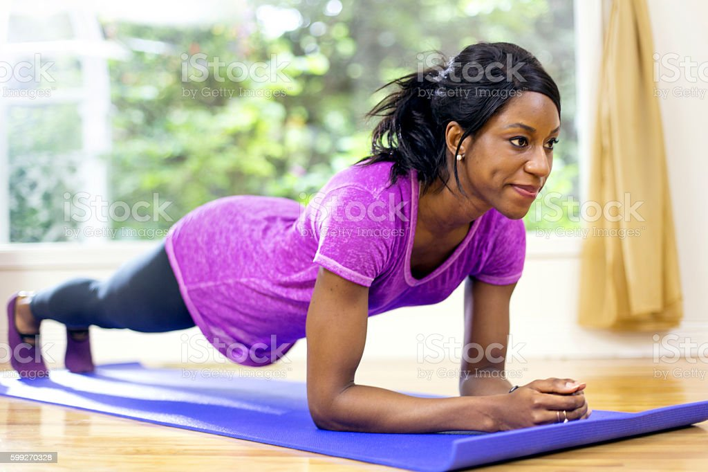 African american female holding a plank stock photo