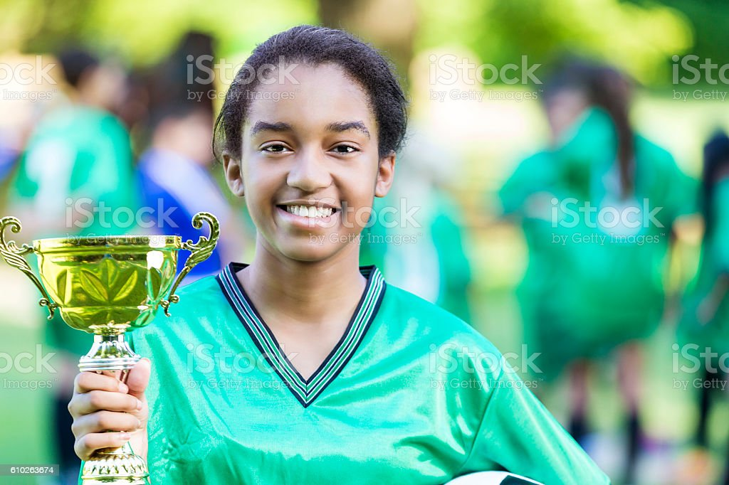 African American female soccer champion stock photo