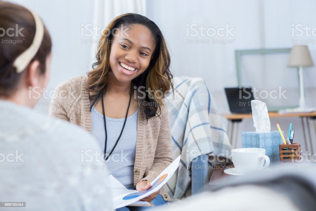 African American financial advisor talks with client stock photo