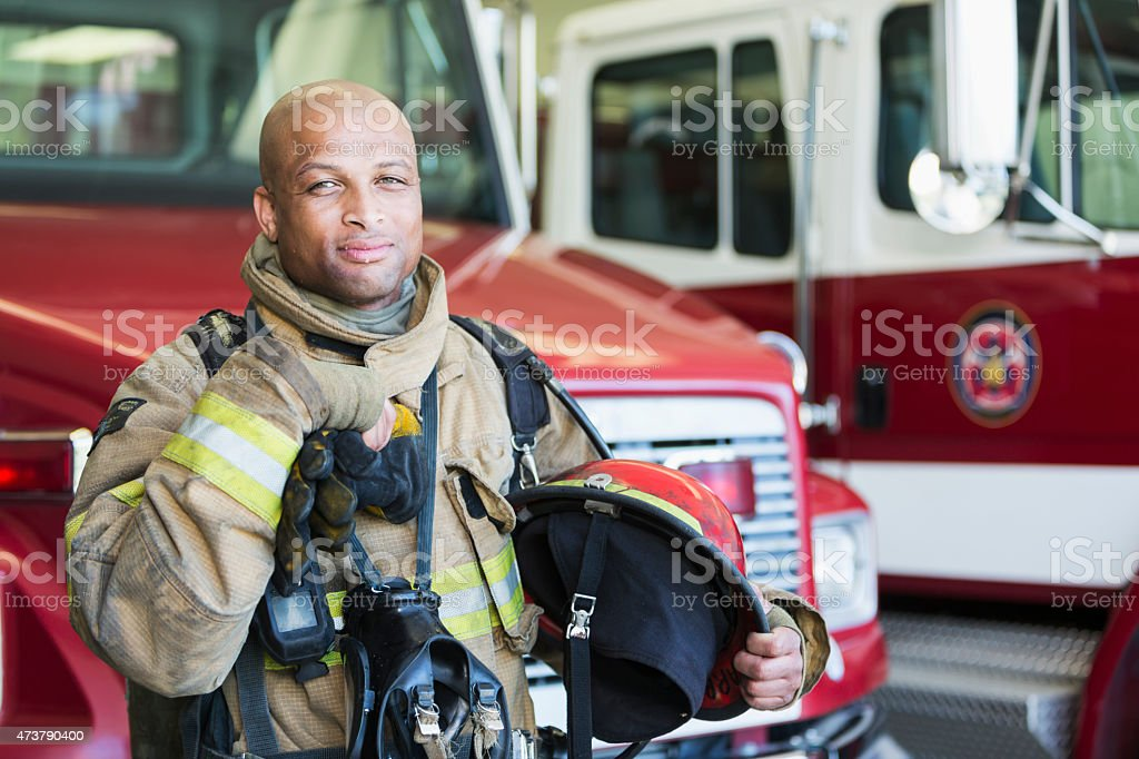 African American fireman at fire station stock photo