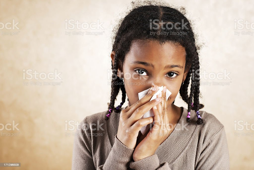 African American girl blowing her nose. royalty-free stock photo