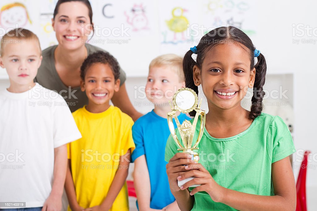 african american girl holding a trophy stock photo