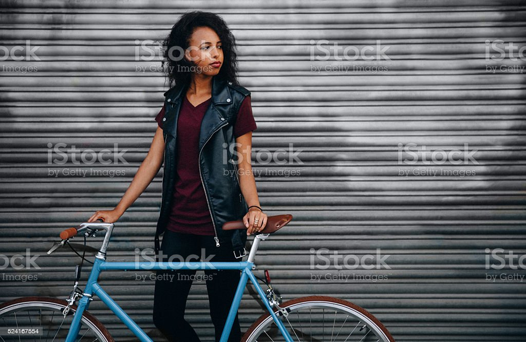 African American girl in front of graffitti with a bicycle stock photo