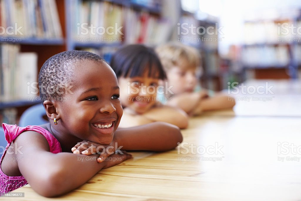 African American girl with friends relaxing in the library royalty-free stock photo