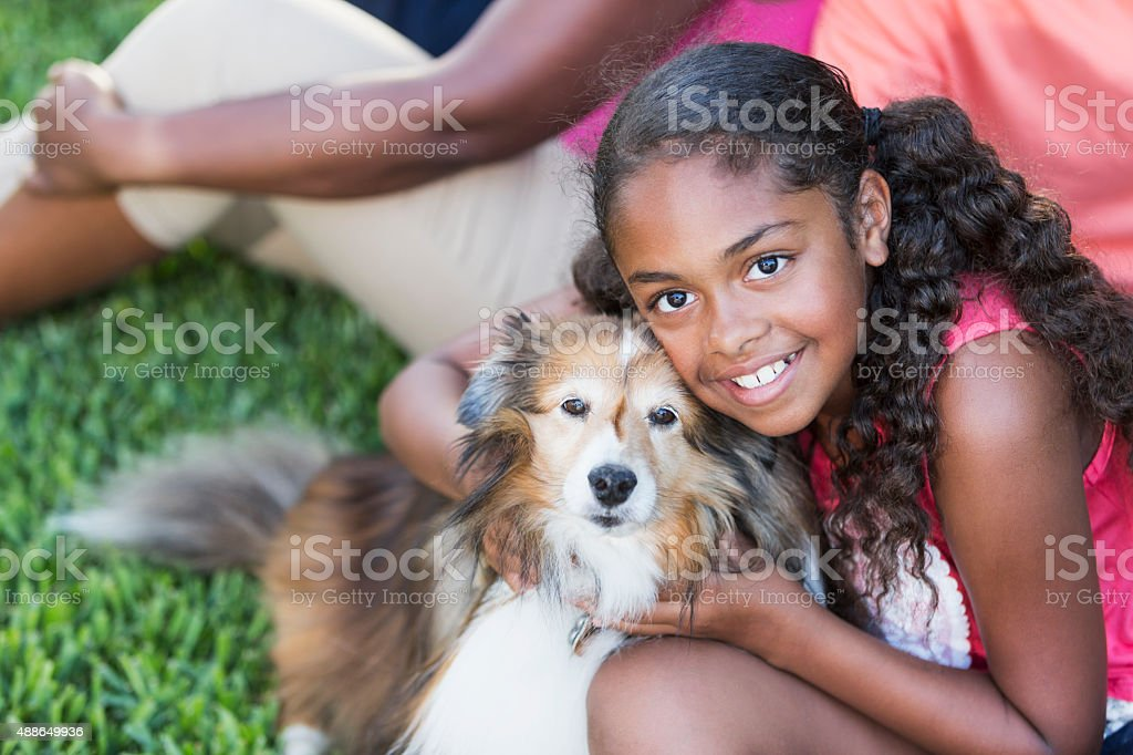 African American girl with pet dog stock photo
