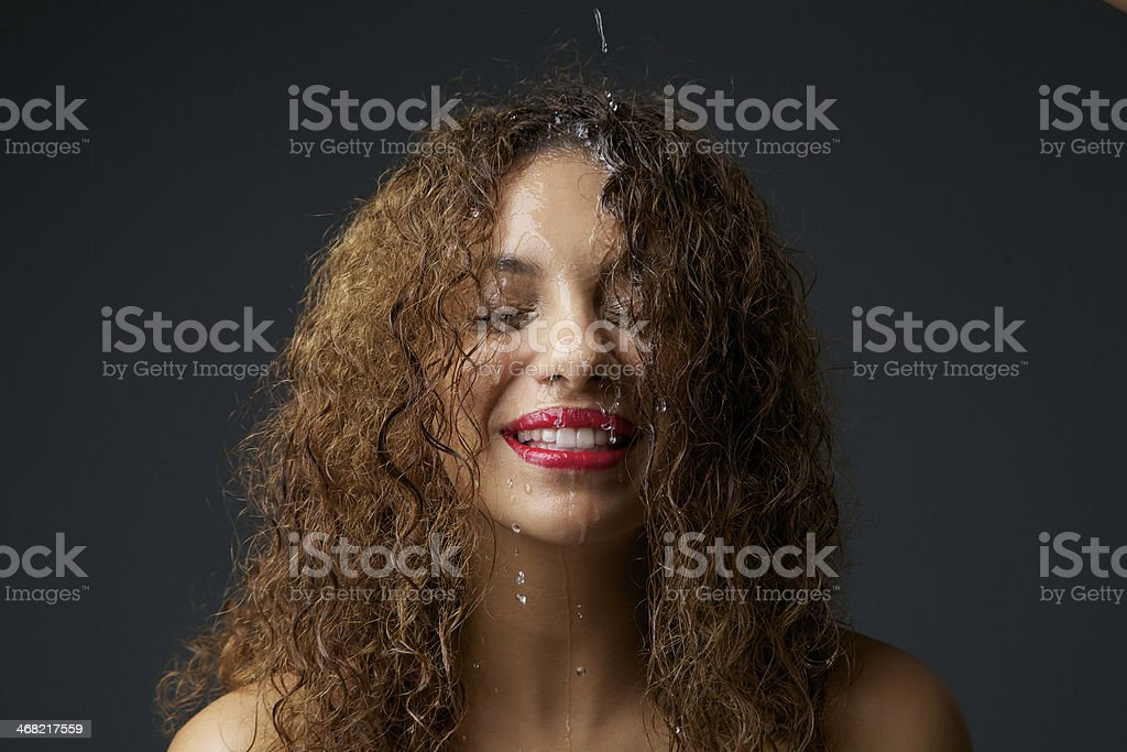 African american girl with water dripping down face royalty-free stock photo