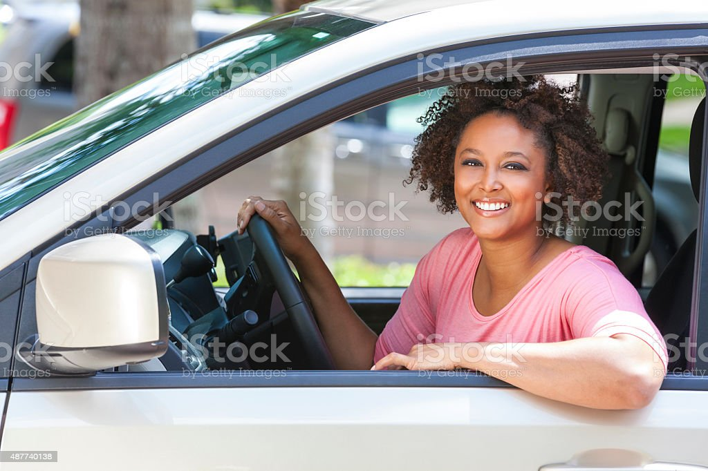 African American Girl Young Woman Driving Car stock photo