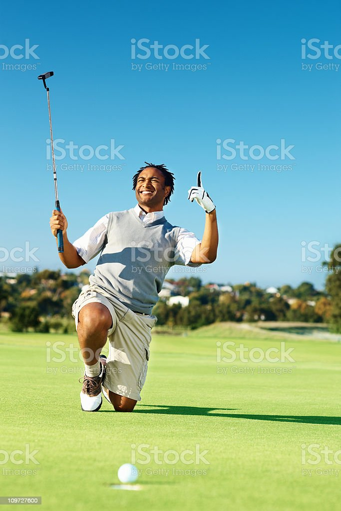 African American golfer at the golf course royalty-free stock photo