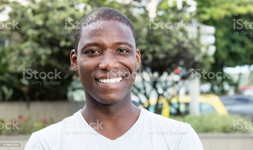 African american guy laughing at camera outdoor stock photo