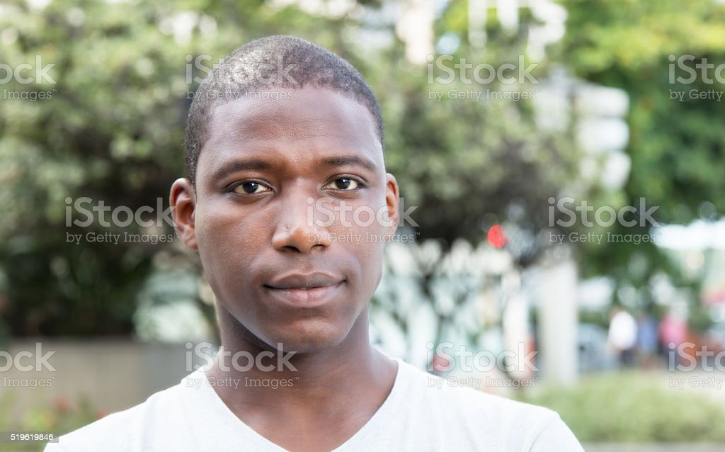 African american guy looking at camera outdoor stock photo