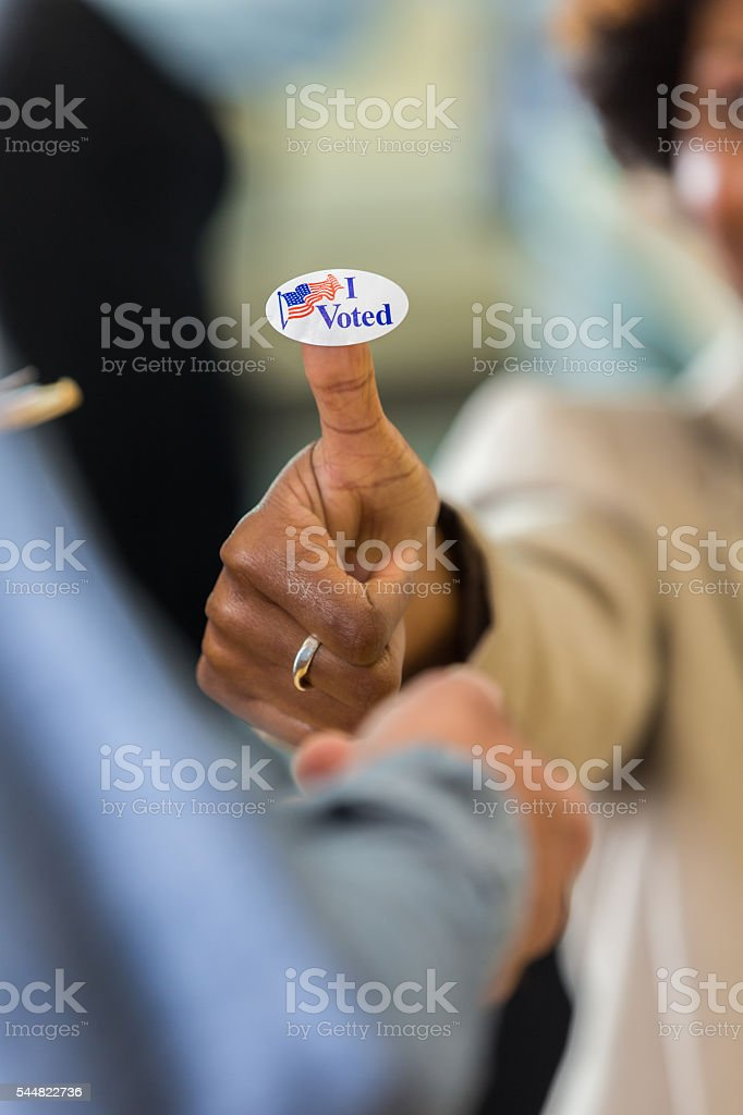 African american hand with I voted sticker stock photo