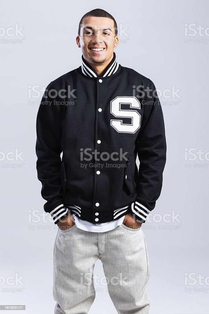 African American High School Student in Letterman Jacket stock photo