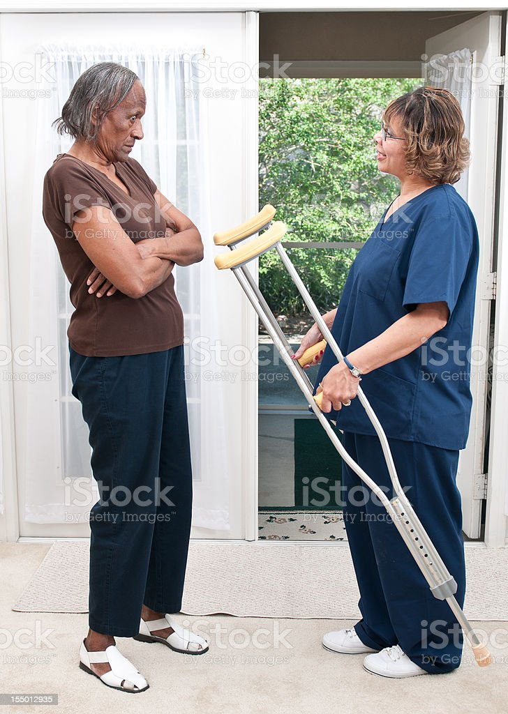African American Home Healtcare Nurse Suggesting Crutches royalty-free stock photo