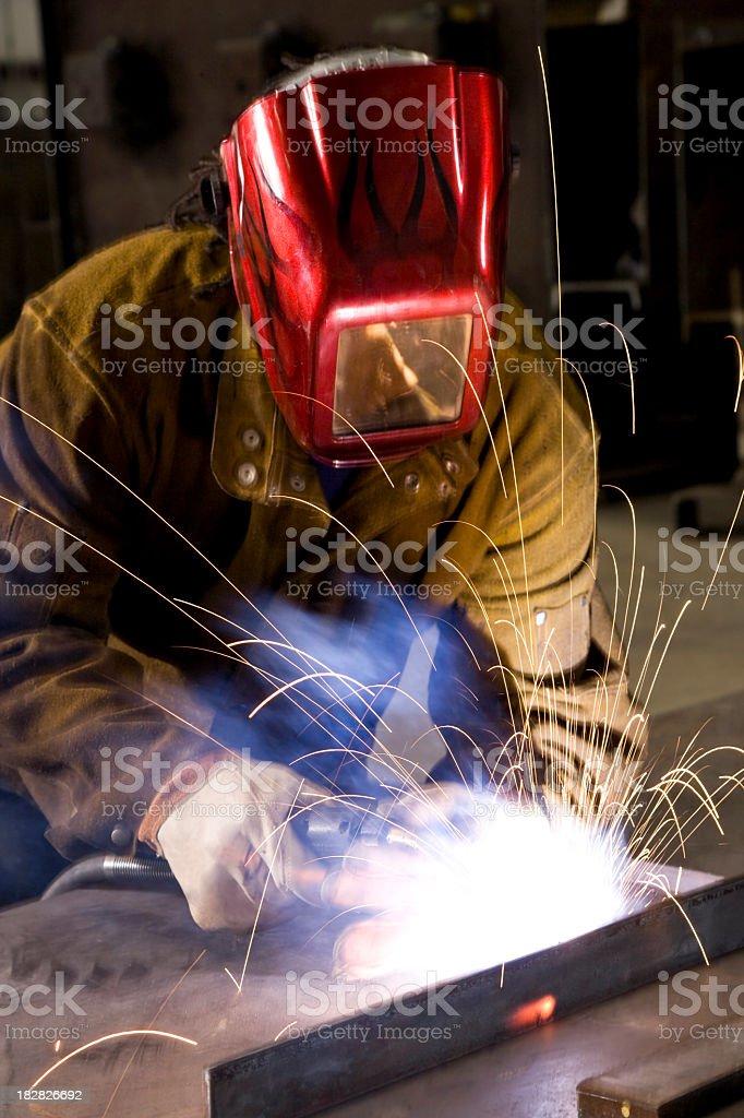 African American industrial worker welding stock photo