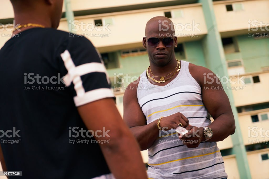 African American Junkie Buying Drug Dose From Hispanic Dealer Pu stock photo