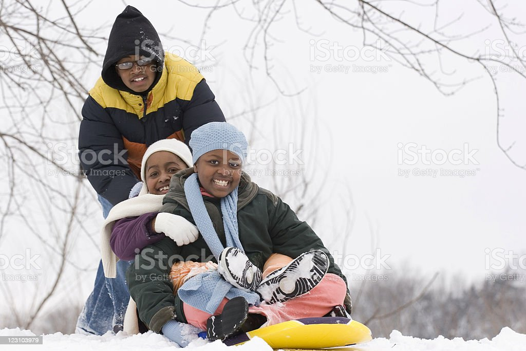 African American kids playing in the snow royalty-free stock photo