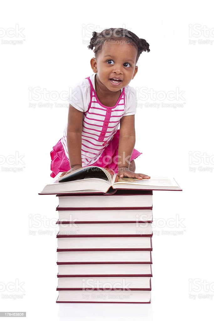 African american little girl reading a book stock photo