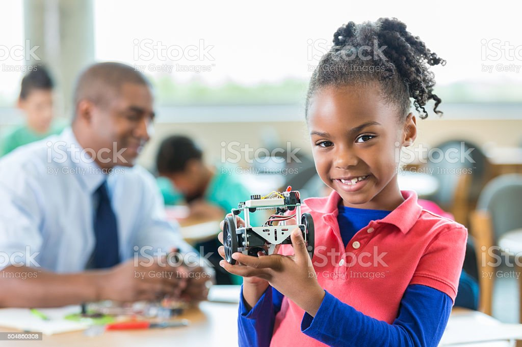 African American little girl using robotics during science class stock photo