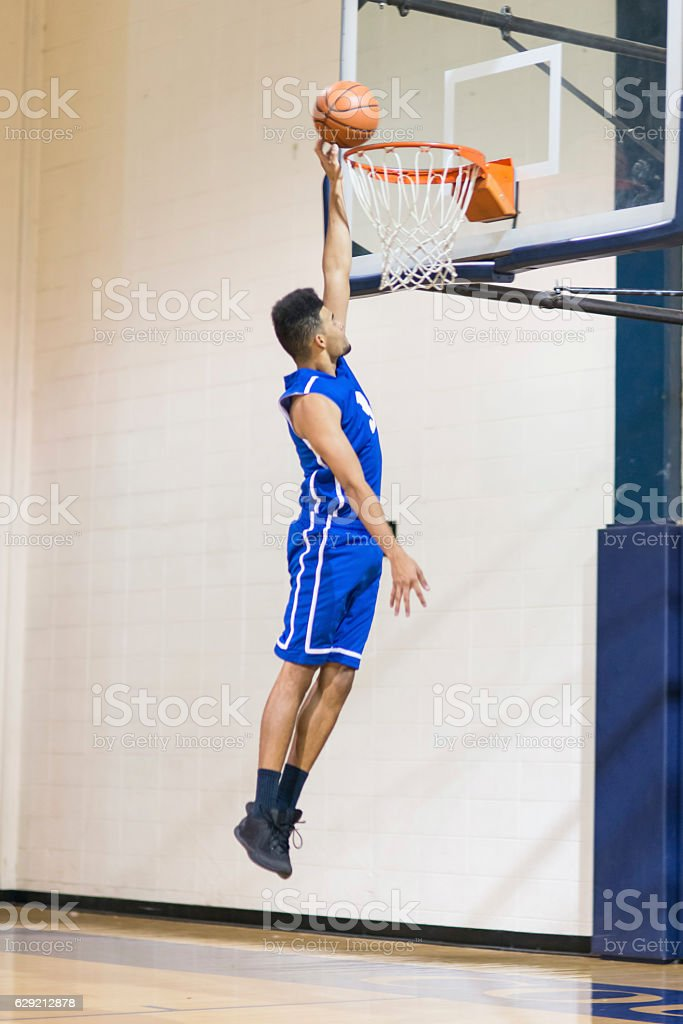 African American male dunking a basketball stock photo