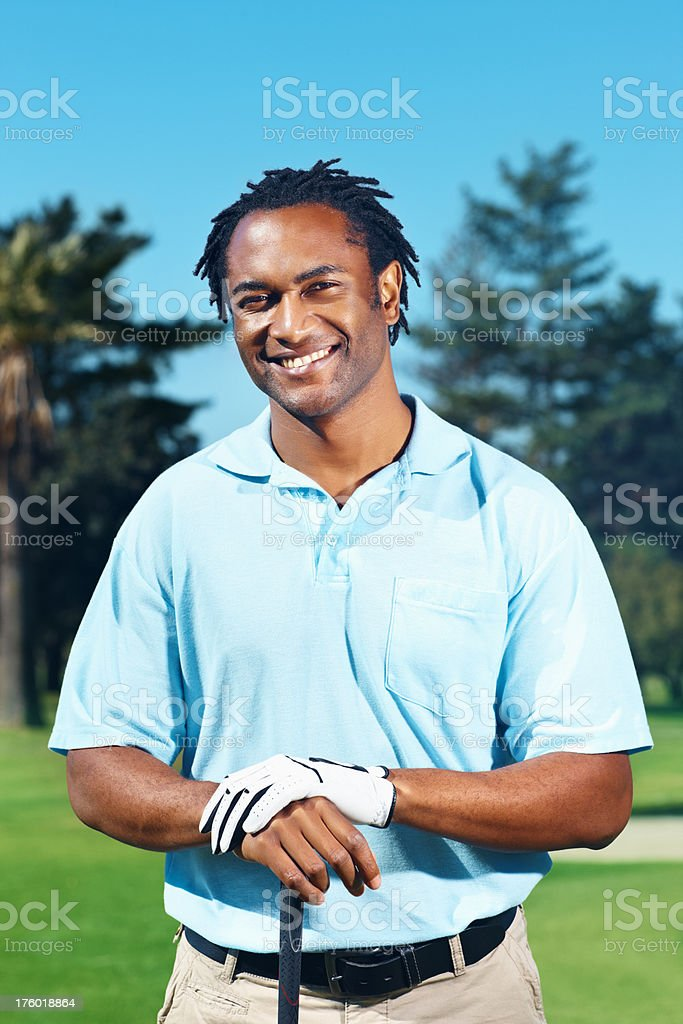 African American male golfer smiling in outdoors royalty-free stock photo