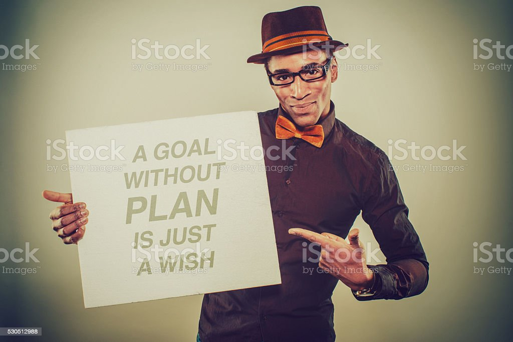 African American Male holding a cardboard stock photo