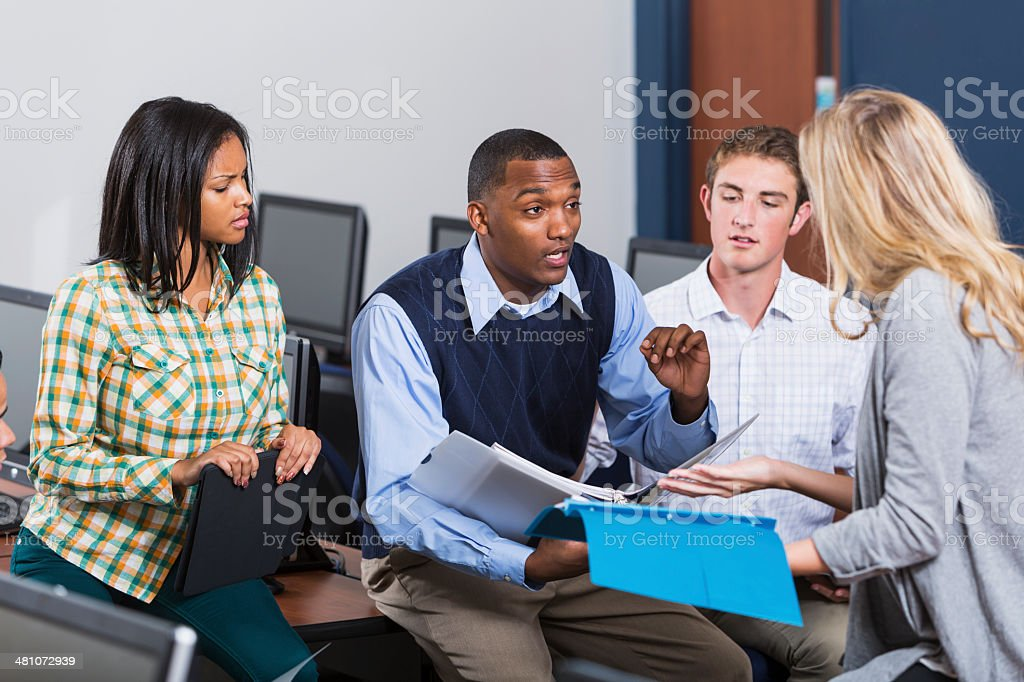 African American male teacher with students in class stock photo