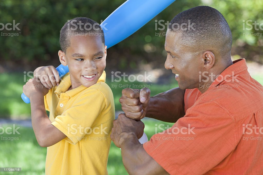 African American Man and Boy Father & Son Playing Baseball stock photo
