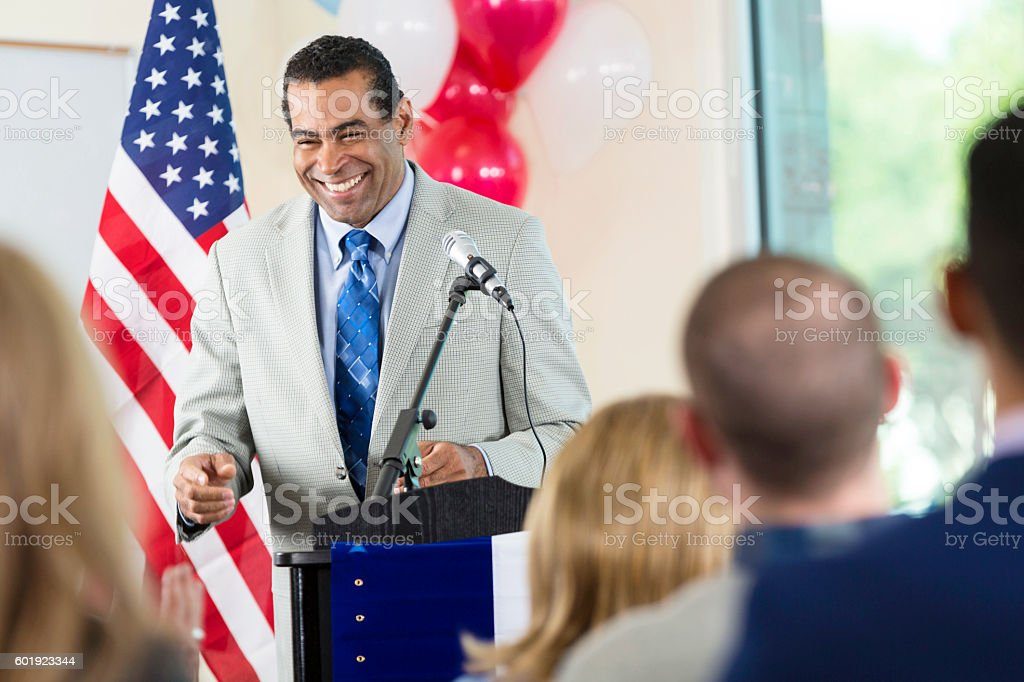 African American man answering questions during political speech stock photo