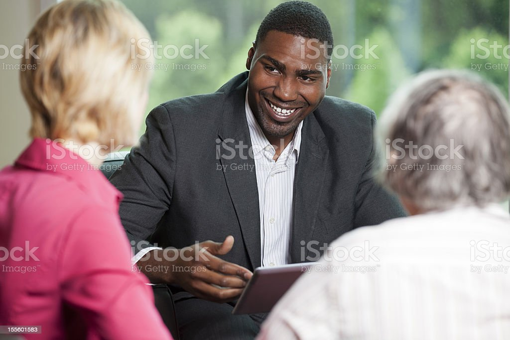 African american man consulting with clients royalty-free stock photo