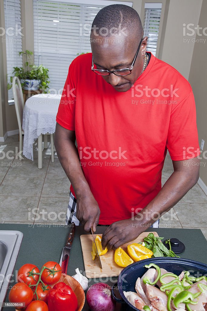 African american man cooking in the home kitchen royalty-free stock photo