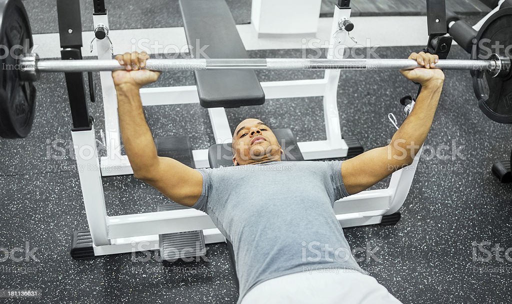 African American man doing bench press. royalty-free stock photo