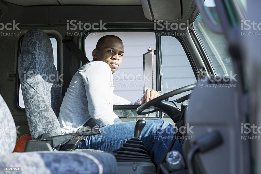 African American man driving truck stock photo