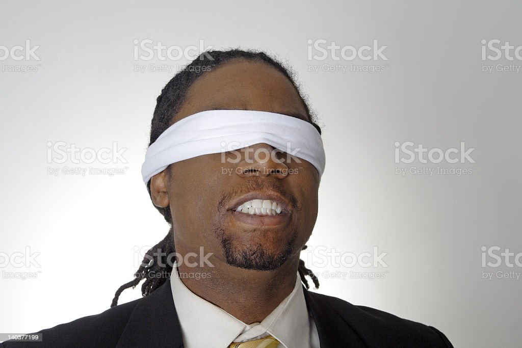 African American Man Gritting Teeth Wearing Blindfold royalty-free stock photo