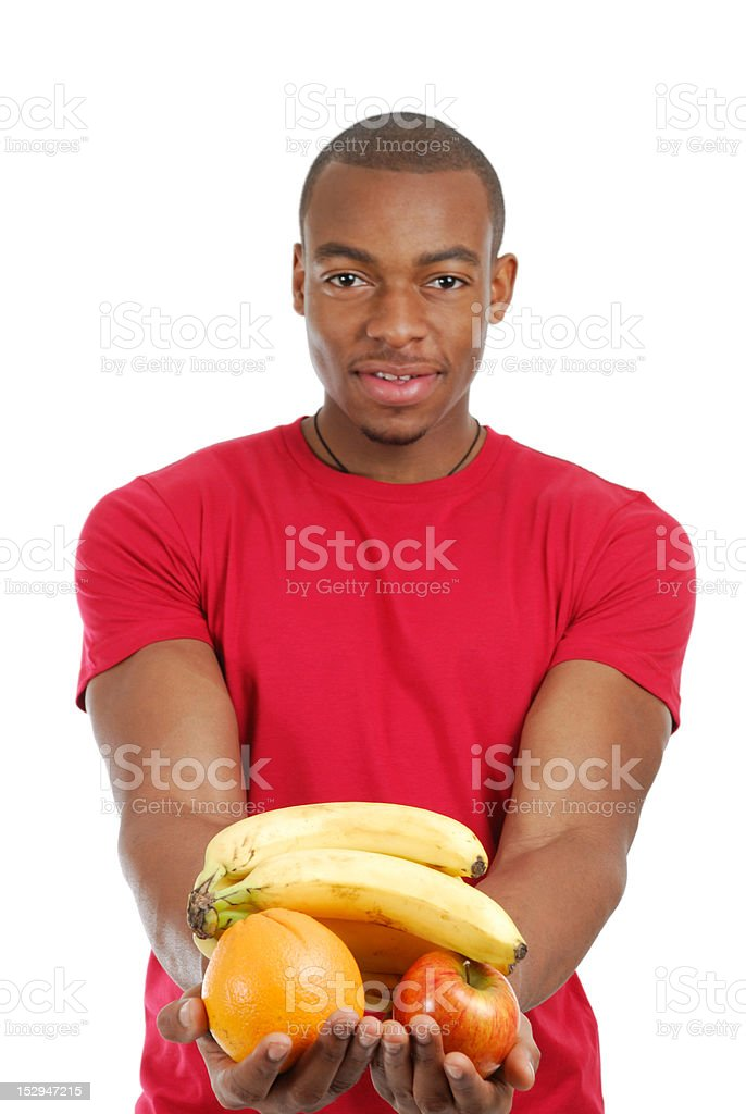 African american man holding fruits royalty-free stock photo