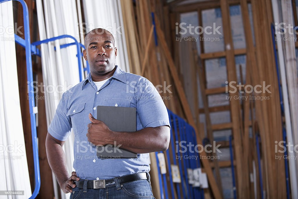 African American man in hardware store stock photo