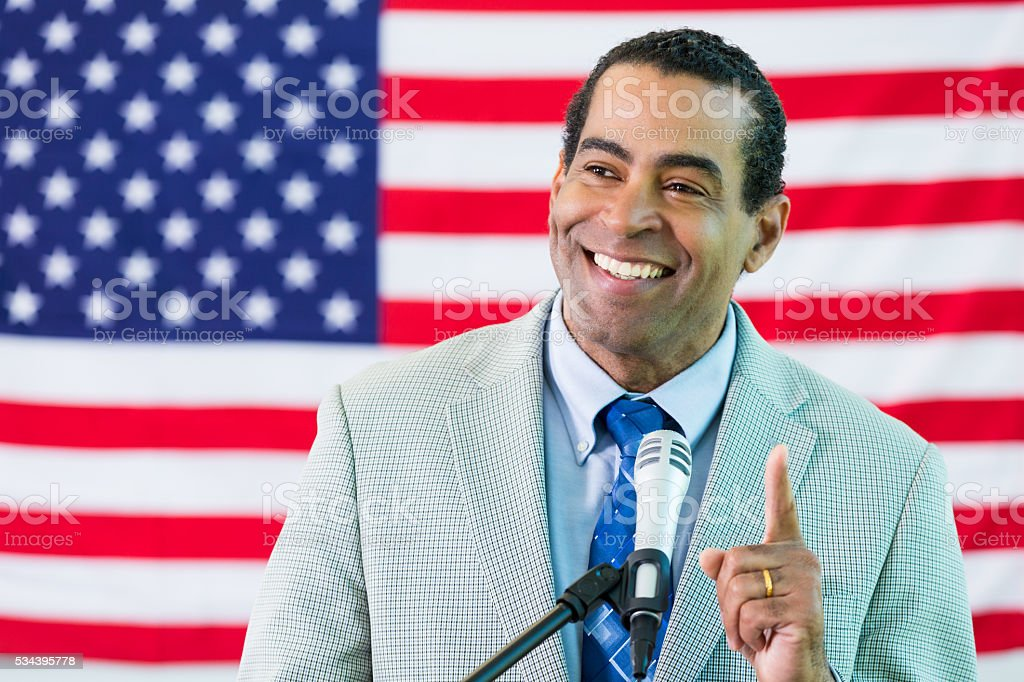 African american man makes speech at a podium stock photo