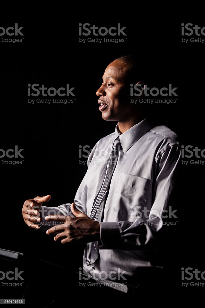 African American Man Making a speech at a podium stock photo