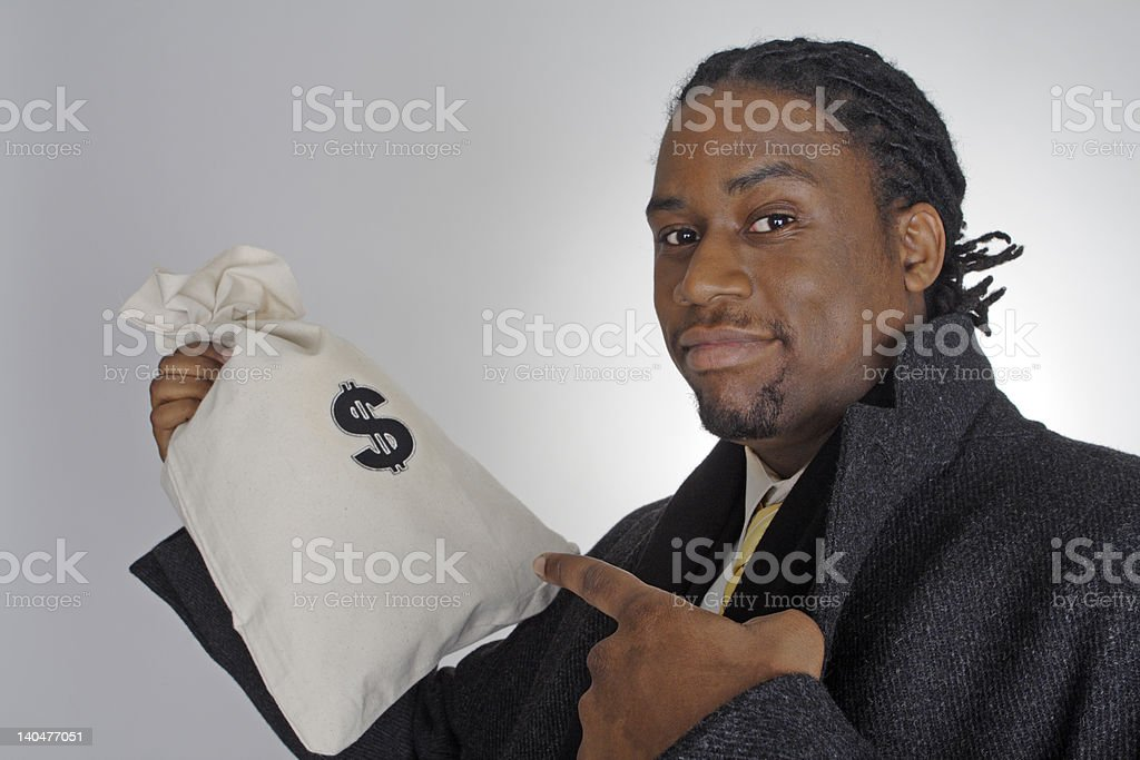 African American Man Pointing to Money Bag royalty-free stock photo