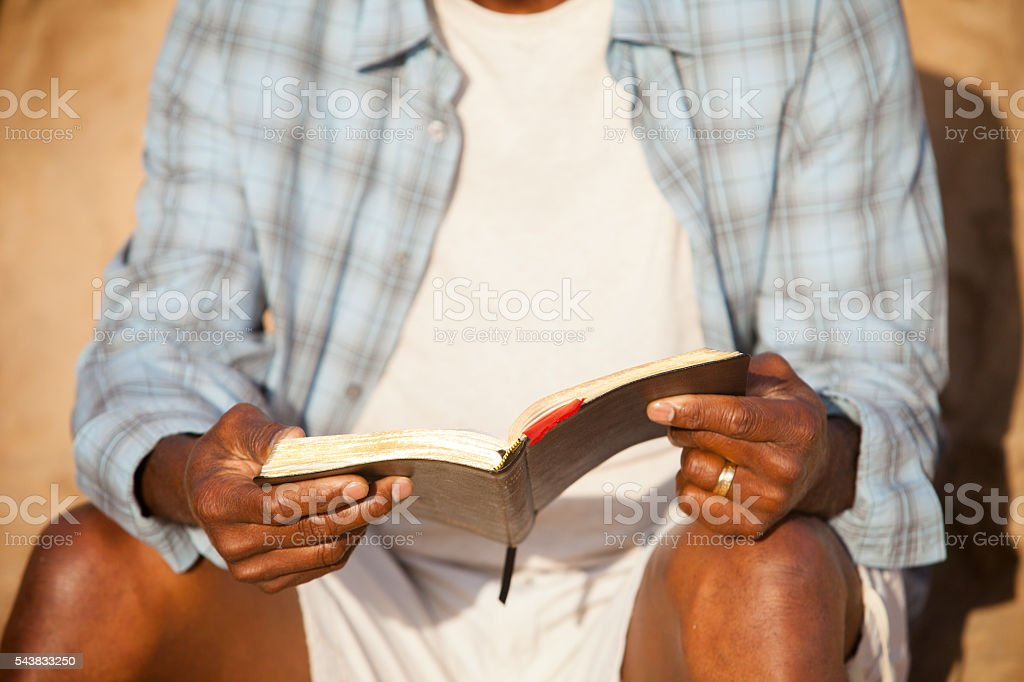 African American Man Reading Bible stock photo