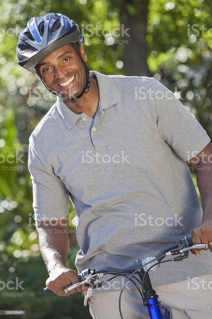 African American Man Riding Bike royalty-free stock photo