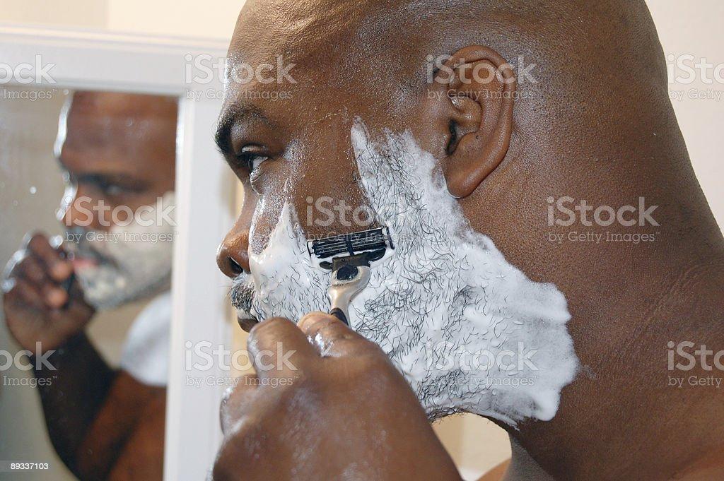 African American man shaving. royalty-free stock photo
