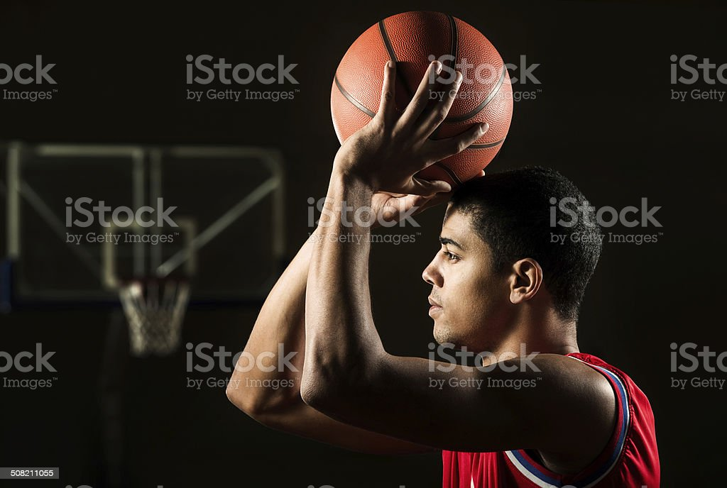 African American man shooting at the hoop. stock photo