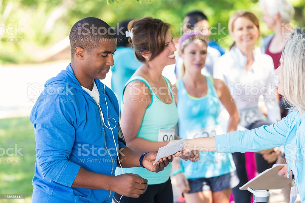 African American man signing up for marathon or 5k race stock photo